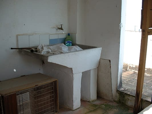 Buying a house and living in Spain with a built in laundry?