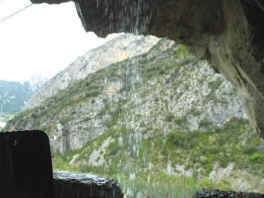 Driving through a waterfall on the way to Plan.